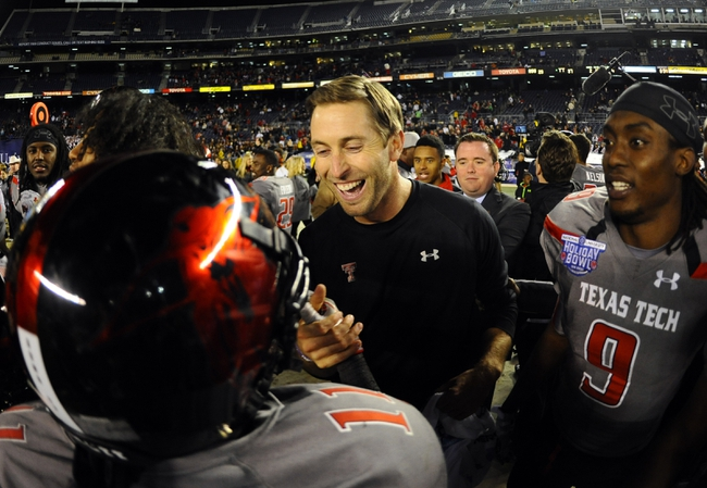 Dec 30, 2013; San Diego, CA, USA; Texas Tech Red Raiders head coach Kliff Kingsbury celebrates with players after a win against the Arizona State Sun Devils in the Holiday Bowl at Qualcomm Stadium. Texas Tech won 37-23. Mandatory Credit: Christopher Hanewinckel-USA TODAY Sports