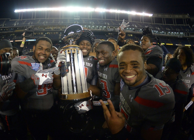Dec 30, 2013; San Diego, CA, USA; Texas Tech Red Raiders players pose with the championship trophy after the 2013 Holiday Bowl against the Arizona State Sun Devils at Qualcomm Stadium. Texas Tech defeated Arizona State 37-23. Mandatory Credit: Kirby Lee-USA TODAY Sports