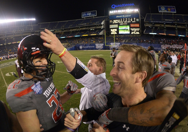 Dec 30, 2013; San Diego, CA, USA; Texas Tech Red Raiders coach Kliff Kingsbury celebrates with tight end Jace Amaro (22) at the end of the 2013 Holiday Bowl against the Arizona State Sun Devils at Qualcomm Stadium. Texas Tech defeated Arizona State 37-23. Mandatory Credit: Kirby Lee-USA TODAY Sports