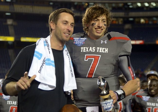 Dec 30, 2013; San Diego, CA, USA; Texas Tech Red Raiders coach Kliff Kingsbury (left) and quarterback Davis Webb (7) pose after the 2013 Holiday Bowl against the Arizona State Sun Devils at Qualcomm Stadium. Texas Tech defeated Arizona State 37-23. Mandatory Credit: Kirby Lee-USA TODAY Sports