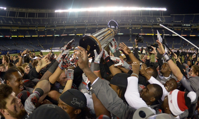 Dec 30, 2013; San Diego, CA, USA; Texas Tech Red Raiders players hoist the championship trophy after the 2013 Holiday Bowl against the Arizona State Sun Devils at Qualcomm Stadium. Texas Tech defeated Arizona State 37-23. Mandatory Credit: Kirby Lee-USA TODAY Sports