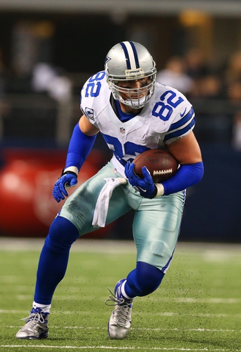 Dec 29, 2013; Arlington, TX, USA; Dallas Cowboys tight end Jason Witten (82) runs after a reception against the Philadelphia Eagles at AT&T Stadium. Mandatory Credit: Matthew Emmons-USA TODAY Sports