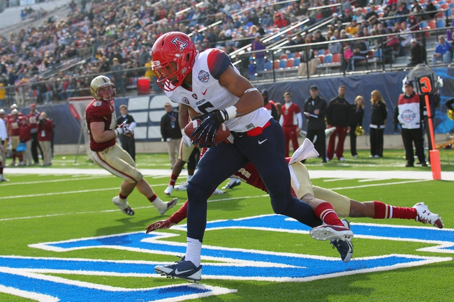 Dec 31, 2013; Shreveport, LA, USA; Arizona Wildcats wide receiver Trey Griffey (5) catches a pass in the end zone for touchdown in the second half against the Boston College Eagles at Independence Stadium. Arizona defeated Boston College 42-19. Mandatory Credit: Crystal LoGiudice-USA TODAY Sports