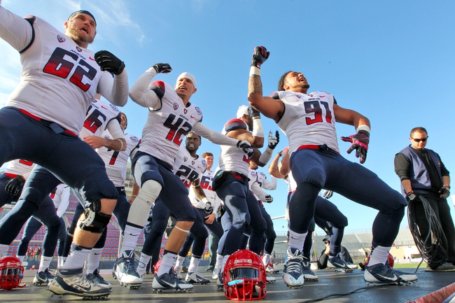 Dec 31, 2013; Shreveport, LA, USA; Arizona Wildcats defensive lineman Sione Tuihalamaka (right) leads teammates in a chant as they celebrate defeating the Boston College Eagles 42-19 at Independence Stadium. Mandatory Credit: Crystal LoGiudice-USA TODAY Sports