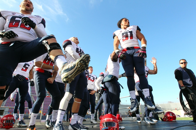 Dec 31, 2013; Shreveport, LA, USA; Arizona Wildcats defensive lineman Sione Tuihalamaka (91) leads his teammates in a chant as they celebrate defeating the Boston College Eagles 42-19 at Independence Stadium. Mandatory Credit: Crystal LoGiudice-USA TODAY Sports