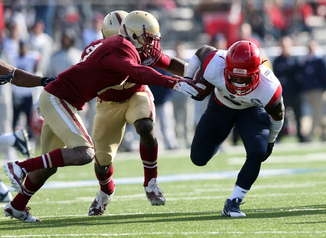 Dec 31, 2013; Shreveport, LA, USA; Arizona Wildcats running back Daniel Jenkins (3) is tackled by Boston College Eagles defensive back Bryce Jones (17) in the second half at Independence Stadium. Arizona defeated Boston College 42-19. Mandatory Credit: Crystal LoGiudice-USA TODAY Sports