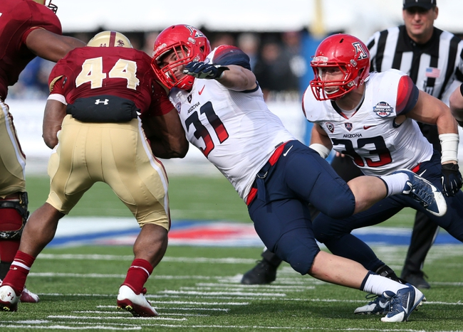 Dec 31, 2013; Shreveport, LA, USA; Arizona Wildcats linebacker Scooby Wright (31) tackles Boston College Eagles running back Andre Williams (44) in the second half at Independence Stadium. Arizona defeated Boston College 42-19. Mandatory Credit: Crystal LoGiudice-USA TODAY Sports