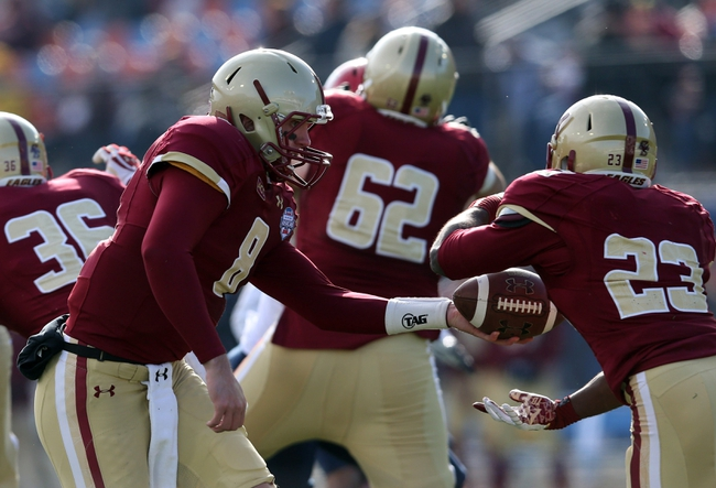 Dec 31, 2013; Shreveport, LA, USA; Boston College Eagles quarterback Josh Bordner (8) hand the ball off to  running back Myles Willis (23) in the second half at Independence Stadium. Arizona defeated Boston College 42-19. Mandatory Credit: Crystal LoGiudice-USA TODAY Sports