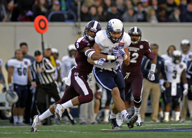 Dec 31, 2013; Memphis, TN, USA; Rice Owls tight end Connor Cella (87) is tackled by Mississippi State Bulldogs defensive back Justin Cox (9) during the first quarter at Liberty Bowl Memorial Stadium. Mandatory Credit: Justin Ford-USA TODAY Sports