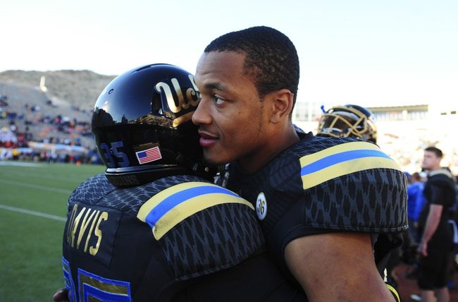 Dec 31, 2013; El Paso, TX, USA; UCLA Bruins quarterback Brett Hundley (17) celebrates with running back Ryan Davis (35) after winning the 2013 Sun Bowl at Sun Bowl Stadium. UCLA defeated Virginia Tech 42-12. Mandatory Credit: Andrew Weber-USA TODAY Sports