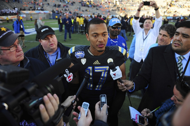Dec 31, 2013; El Paso, TX, USA; UCLA Bruins quarterback Brett Hundley (17) is interviewed my members of the media after winning the 2013 Sun Bowl at Sun Bowl Stadium. UCLA defeated Virginia Tech 42-12. Mandatory Credit: Andrew Weber-USA TODAY Sports
