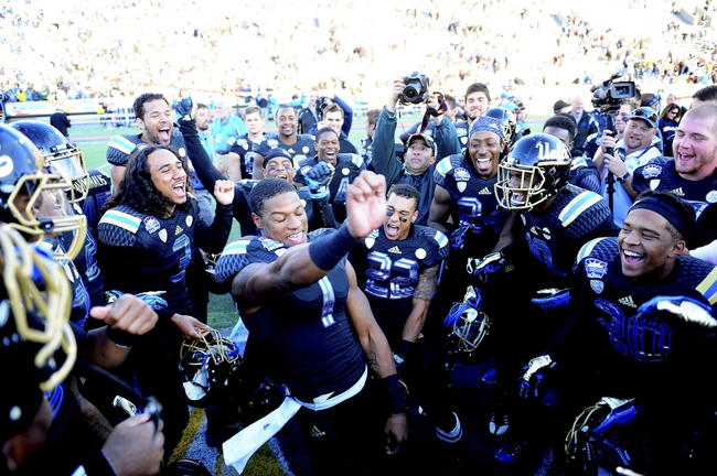 Dec 31, 2013; El Paso, TX, USA; UCLA Bruins wide receiver Shaquelle Evans (1) celebrates with teammates after winning the 2013 Sun Bowl at Sun Bowl Stadium. UCLA defeated Virginia Tech 42-12. Mandatory Credit: Andrew Weber-USA TODAY Sports