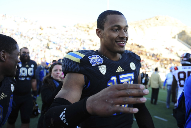 Dec 31, 2013; El Paso, TX, USA; UCLA Bruins quarterback Brett Hundley (17) celebrates after winning the 2013 Sun Bowl at Sun Bowl Stadium. UCLA defeated Virginia Tech 42-12. Mandatory Credit: Andrew Weber-USA TODAY Sports
