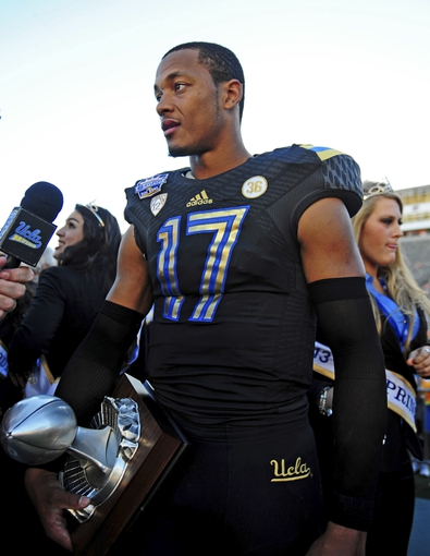 Dec 31, 2013; El Paso, TX, USA; UCLA Bruins quarterback Brett Hundley (17) holds his MVP trophy after winning the 2013 Sun Bowl at Sun Bowl Stadium. UCLA defeated Virginia Tech 42-12. Mandatory Credit: Andrew Weber-USA TODAY Sports