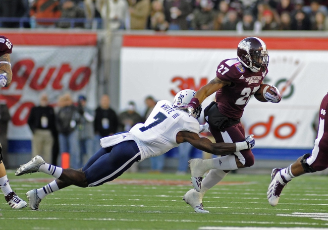 Dec 31, 2013; Memphis, TN, USA; Rice Owls safety Julius White (7) tackles Mississippi State Bulldogs running back LaDarius Perkins (27) during the second quarter at Liberty Bowl Memorial Stadium. Mandatory Credit: Justin Ford-USA TODAY Sports