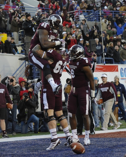 Dec 31, 2013; Memphis, TN, USA; Mississippi State Bulldogs tight end Artimas Samuel (85) celebrates with Mississippi State Bulldogs offensive linesman Dillon Day (63) during the second quarter after a touchdown at Liberty Bowl Memorial Stadium. Mandatory Credit: Justin Ford-USA TODAY Sports