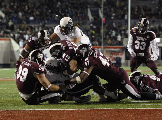 Dec 31, 2013; Memphis, TN, USA; Mississippi State Bulldogs defensive lineman Ryan Brown (48) and Mississippi State Bulldogs linebacker Richie Brown (39) take down Rice Owls running back Jawon Davis (3) during the second half at Liberty Bowl Memorial Stadium. Mississippi State Bulldogs beat Rice Owls 44 - 7. Mandatory Credit: Justin Ford-USA TODAY Sports