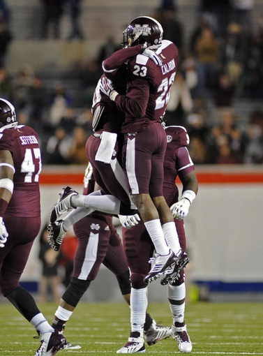 Dec 31, 2013; Memphis, TN, USA; Mississippi State Bulldogs defensive back Taveze Calhoun (23) celebrates after play against the Rice Owls during the second half at Liberty Bowl Memorial Stadium. Mississippi State Bulldogs beat Rice Owls 44 - 7. Mandatory Credit: Justin Ford-USA TODAY Sports