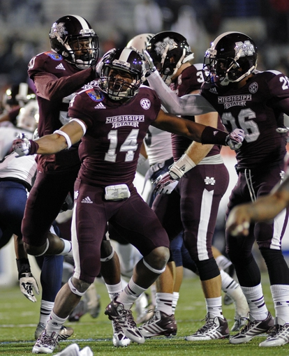 Dec 31, 2013; Memphis, TN, USA; Mississippi State Bulldogs linebacker Zach Jackson (14) celebrates after play against the Rice Owls during the second half at Liberty Bowl Memorial Stadium. Mississippi State Bulldogs beat Rice Owls 44 - 7. Mandatory Credit: Justin Ford-USA TODAY Sports