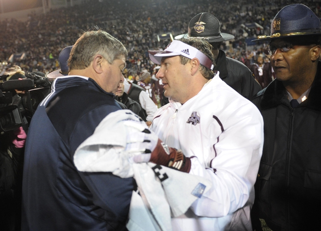 Dec 31, 2013; Memphis, TN, USA; Mississippi State Bulldogs head coach Dan Mullen and Rice Owls head coach David Bailiff after the game at Liberty Bowl Memorial Stadium. Mississippi State Bulldogs beat Rice Owls 44 - 7. Mandatory Credit: Justin Ford-USA TODAY Sports