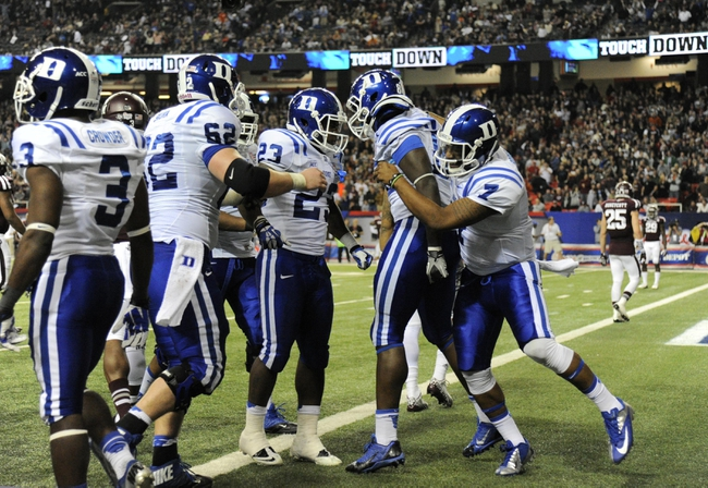 Dec 31, 2013; Atlanta, GA, USA;  Duke Blue Devils quarterback Anthony Boone (7) celebrates with David Reeves (80) after Boone scored a touchdown in the fourth quarter against the Texas A&M Aggies in the 2013 Chick-fil-a Bowl at the Georgia Dome. Mandatory Credit: Dale Zanine-USA TODAY Sports