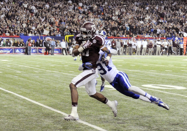 Dec 31, 2013; Atlanta, GA, USA;  Texas A&M Aggies wide receiver Derel Walker (11) catches a 45 yard touchdown pass ahead of Duke Blue Devils cornerback Breon Borders (31) during the fourth quarter in the 2013 Chick-fil-a Bowl at the Georgia Dome. Mandatory Credit: Dale Zanine-USA TODAY Sports