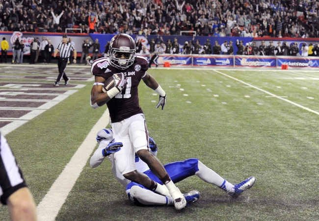 Dec 31, 2013; Atlanta, GA, USA;  Texas A&M Aggies wide receiver Derel Walker (11) scores on a 45 yard touchdown pass ahead of Duke Blue Devils cornerback Breon Borders (31) during the fourth quarter in the 2013 Chick-fil-a Bowl at the Georgia Dome. Mandatory Credit: Dale Zanine-USA TODAY Sports