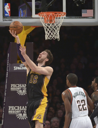 Dec 31, 2013; Los Angeles, CA, USA; Los Angeles Lakers forward Pau Gasol (16) shoots the ball against the Milwaukee Bucks at Staples Center. Mandatory Credit: Kirby Lee-USA TODAY Sports