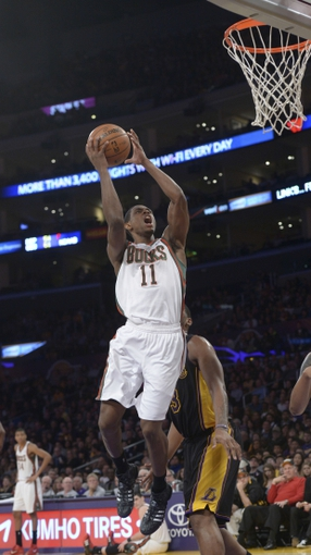 Dec 31, 2013; Los Angeles, CA, USA; Milwaukee Bucks guard Brandon Knight (11) shoots the ball against the Los Angeles Lakers at Staples Center. Mandatory Credit: Kirby Lee-USA TODAY Sports