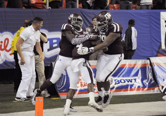 Dec 31, 2013; Atlanta, GA, USA;  Texas A&M Aggies defensive back Toney Hurd Jr. (4) celebrates his touchdown with Steven Jenkins (8) and Isaiah Golden (99)  against the Duke Blue Devils in the fourth quarter of the 2013 Chick-fil-a Bowl at the Georgia Dome. Mandatory Credit: Dale Zanine-USA TODAY Sports