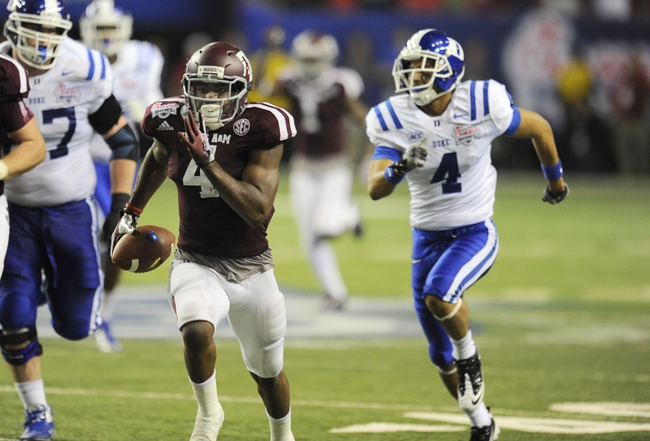 Dec 31, 2013; Atlanta, GA, USA;  Texas A&M Aggies defensive back Toney Hurd Jr. (4) returns an interception ahead of Duke Blue Devils wide receiver Johnell Barnes (4) 55 yards for a touchdown in the fourth quarter in the 2013 Chick-fil-a Bowl at the Georgia Dome. Mandatory Credit: Dale Zanine-USA TODAY Sports