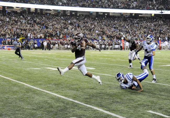 Dec 31, 2013; Atlanta, GA, USA;  Texas A&M Aggies defensive back Toney Hurd Jr. (4) returns an interception ahead of Duke Blue Devils wide receiver Johnell Barnes (4) and Anthony Boone (7) 55 yards for a touchdown in the fourth quarter in the 2013 Chick-fil-a Bowl at the Georgia Dome. Mandatory Credit: Dale Zanine-USA TODAY Sports