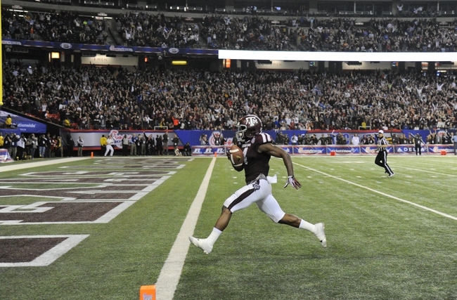 Dec 31, 2013; Atlanta, GA, USA;  Texas A&M Aggies defensive back Toney Hurd Jr. (4) returns an interception 55 yards for a touchdown in the fourth quarter against the Duke Blue Devils in the 2013 Chick-fil-a Bowl at the Georgia Dome. Mandatory Credit: Dale Zanine-USA TODAY Sports