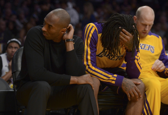 Dec 31, 2013; Los Angeles, CA, USA; Los Angeles Lakers guard Kobe Bryant (left) and forward Jordan Hill react in the fourth quarter against the Milwaukee Bucks at Staples Center. The Bucks defeated the Lakers 94-79. Mandatory Credit: Kirby Lee-USA TODAY Sports