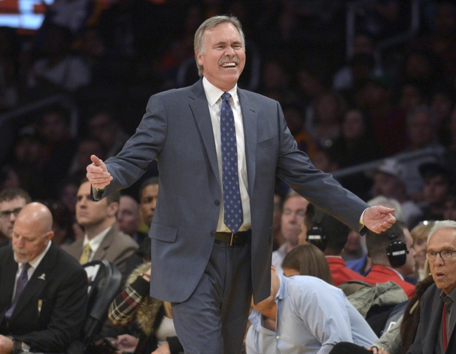Dec 31, 2013; Los Angeles, CA, USA; Los Angeles Lakers coach Mike D'Antoni reacts during the game against the Milwaukee Bucks at Staples Center. The Bucks defeated the Lakers 94-79. Mandatory Credit: Kirby Lee-USA TODAY Sports