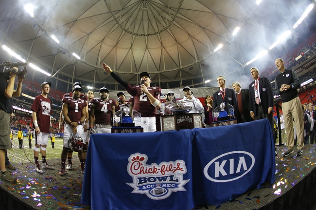 Dec 31, 2013; Atlanta, GA, USA; Texas A&M Aggies quarterback Johnny Manziel (2) celebrates with his teammates after defeating the Duke Blue Devils during the 2013 Chick-fil-A Bowl at the Georgia Dome. Texas A&M won 52-48. Mandatory Credit: Paul Abell-USA TODAY Sports