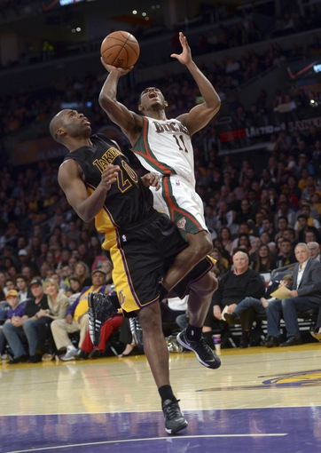 Dec 31, 2013; Los Angeles, CA, USA; Milwaukee Bucks guard Brandon Knight (11) is defended by Los Angeles Lakers guard Jodie Meeks (20) during the game at Staples Center. The Bucks defeated the Lakers 94-79. Mandatory Credit: Kirby Lee-USA TODAY Sports