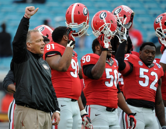 Dec 22, 2013; Jacksonville, FL, USA; Georgia Bulldogs head coach Mark Richt leads his team before the game against the Nebraska Cornhuskers at EverBank Field. Mandatory Credit: Melina Vastola-USA TODAY Sports
