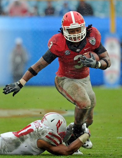 Jan 1, 2014; Jacksonville, FL, USA; Georgia Bulldogs running back Todd Gurley (3) runs the ball during the second half of the game against the Nebraska Cornhuskers at EverBank Field . Mandatory Credit: Melina Vastola-USA TODAY Sports