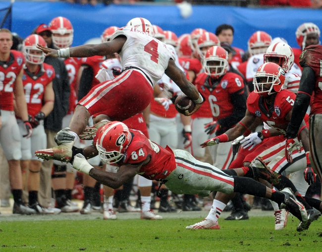 Jan 1, 2014; Jacksonville, FL, USA; Georgia Bulldogs outside linebacker Leonard Floyd (84) tackles Nebraska Cornhuskers quarterback Tommy Armstrong Jr. (4) during the second half at EverBank Field . Mandatory Credit: Melina Vastola-USA TODAY Sports