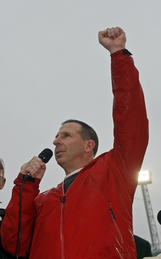Jan 1, 2014; Jacksonville, FL, USA; Nebraska Cornhuskers head coach Bo Pelini raises his fist as he speaks to fans after their game against the Georgia Bulldogs at EverBank Field. The Nebraska Cornhuskers beat the Georgia Bulldogs 24-19. Mandatory Credit: Phil Sears-USA TODAY Sports