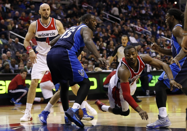 Jan 1, 2014; Washington, DC, USA;  Washington Wizards point guard John Wall (2) is tripped while dribbling the ball by Dallas Mavericks center DeJuan Blair (45) in the second quarter at Verizon Center. Mandatory Credit: Geoff Burke-USA TODAY Sports