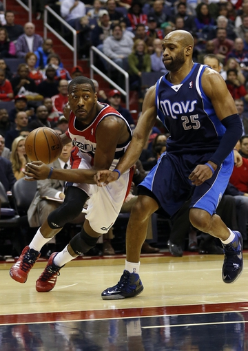 Jan 1, 2014; Washington, DC, USA;  Washington Wizards point guard John Wall (2) dribbles the ball past Dallas Mavericks shooting guard Vince Carter (25) in the second quarter at Verizon Center. Mandatory Credit: Geoff Burke-USA TODAY Sports