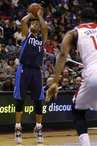 Jan 1, 2014; Washington, DC, USA;  Dallas Mavericks shooting guard Monta Ellis (11) shoots the ball in front of Washington Wizards center Kevin Seraphin (13) in the third quarter at Verizon Center. The Mavericks won 87-78. Mandatory Credit: Geoff Burke-USA TODAY Sports