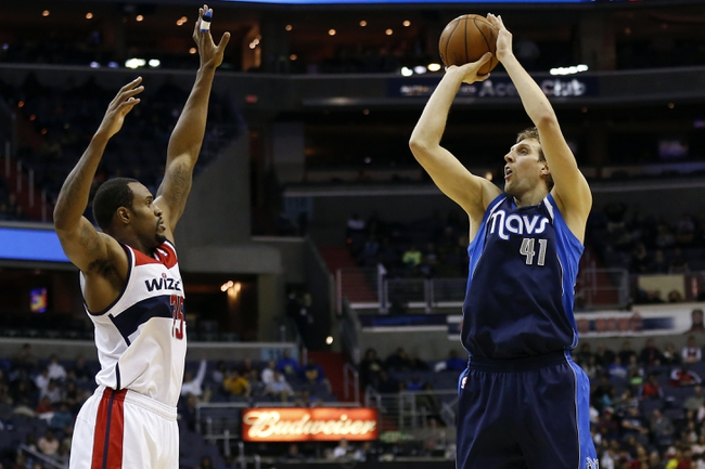 Jan 1, 2014; Washington, DC, USA;  Dallas Mavericks power forward Dirk Nowitzki (41) shoots the ball over Washington Wizards power forward Trevor Booker (35) in the third quarter at Verizon Center. The Mavericks won 87-78. Mandatory Credit: Geoff Burke-USA TODAY Sports