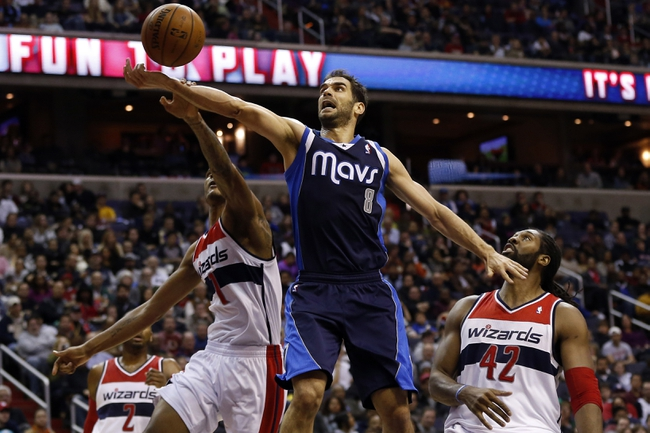 Jan 1, 2014; Washington, DC, USA;  Washington Wizards small forward Trevor Ariza (1) blocks the shot of Dallas Mavericks point guard Jose Calderon (8) in the third quarter at Verizon Center. The Mavericks won 87-78. Mandatory Credit: Geoff Burke-USA TODAY Sports