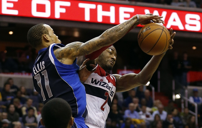 Jan 1, 2014; Washington, DC, USA;  Dallas Mavericks shooting guard Monta Ellis (11) and Washington Wizards point guard John Wall (2) battle for the ball in the fourth quarter at Verizon Center. The Mavericks won 87-78. Mandatory Credit: Geoff Burke-USA TODAY Sports