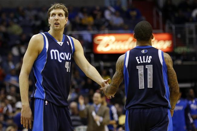 Jan 1, 2014; Washington, DC, USA;  Dallas Mavericks power forward Dirk Nowitzki (41) celebrates with Mavericks shooting guard Monta Ellis (11) on the court during a stoppage in play against the Washington Wizards in the fourth quarter at Verizon Center. The Mavericks won 87-78. Mandatory Credit: Geoff Burke-USA TODAY Sports