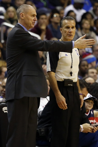 Jan 1, 2014; Washington, DC, USA;  Dallas Mavericks head coach Rick Carlisle (L) argues a call with referee Ken Mauer (41) against the Washington Wizards in the third quarter at Verizon Center. The Mavericks won 87-78. Mandatory Credit: Geoff Burke-USA TODAY Sports