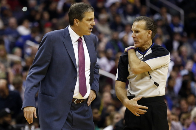 Jan 1, 2014; Washington, DC, USA;  Washington Wizards head coach Randy Wittman (L) argues a call with referee Ken Mauer (41) against the Dallas Mavericks in the fourth quarter at Verizon Center. The Mavericks won 87-78. Mandatory Credit: Geoff Burke-USA TODAY Sports